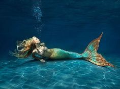 Which Mythical Being are You? I am a Mermaid and I'm very pleased about that! :)
