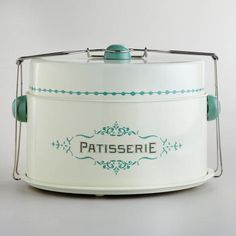 I WANT THIS! So freaking cute for the baker nut I am!  WorldMarket.com: Cream Patisserie Cake Carrier