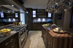 Kitchen By: Christopher Peacock. The kitchen island incorporates a wood block in the corner.