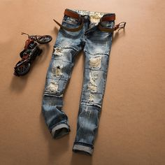 2016 New designer famous brand upscale cotton men jeans ripped pants, European and American style jeans male biker trouser