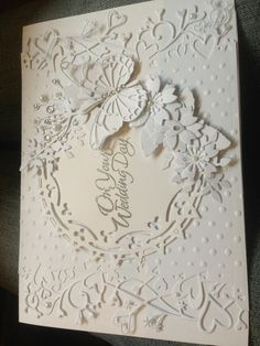 a wedding card using a mixture of Memory box and Marianne dies