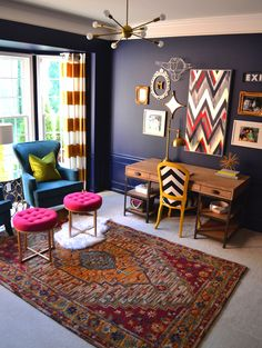 Full shot of the office, complete with Home Goods accessories! Mini fur rug adds layered texture. Chevron chair is a pop of unexpected fun. Metal bull head is a great addition to the gallery wall. And let's not forget both lamps! Lighting can be functional and fabulous. {Sponsored}