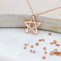 A gorgeous delicate rose gold open star necklace with a few sparkly  cubic zirconia pave crystals to glimmer and shimmer as they catch the  light#jewellery #jewelry #star #necklace #single #rosegold #wedding #boho #christmas #three #dainty #pendant