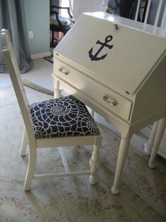 Nautical Desk and chair. Give wooden furniture a nautical makeover with chrome fittings and navy and white paint and fabric.