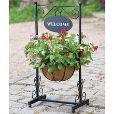 Add a decorative touch to the exterior of your home with this Gardman Blacksmith Welcome Planter. It includes a welcome sign on top and a decorative basket on the bottom for displaying a floral arrangement of your choosing. This handsome planter would loo