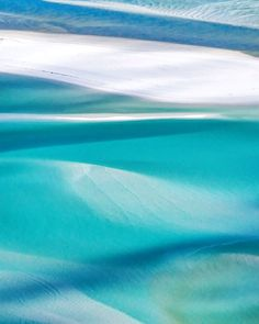 Morning shadows dancing across shallow waters by whitsundaysphotography