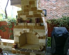 Beautiful #stone work outdoor #fireplace by DH Landscape Design