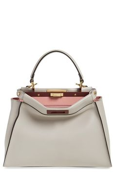 Free shipping and returns on Fendi 'Peek-A-Boo' Medium Crossbody Bag at Nordstrom.com. A pristinely stitched, immaculate calfskin satchel opens to reveal a flash of rich and gorgeous color—while an optional crossbody strap lets you switch in a instant from handheld to over-the-shoulder carry.