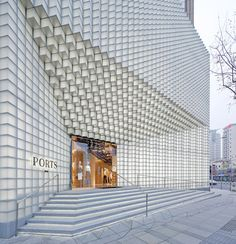 Glass blocks are arranged in a meticulous gridded pattern across the walls of this shop.