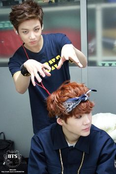 Jungkook and Suga. I will now creep over my hyungs head, because I can.