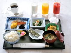 Traditional style This is breakfast in a common home. The main dish is a broiled fish, rice, miso soup. After eating the Japanese style breakfast, a lot of modern people drink coffee and milk, etc. A yellow drink is an orange juice, and red is tomato juice.