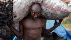 Man carrying coals - Dar es Salaam