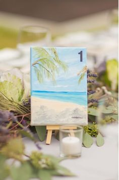 Pretty Table Number Idea-- Petite Paintings - Have pretty scenes painted onto mini canvases and propped onto little easels for an artistic touch.