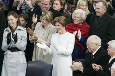 Family members and colleagues of U.S. President George W. Bush clap following his speech during inaugural ceremonies on the west front of the U.S. Capitol January 20, 2005 in Washington, DC. Pictured (L-R) are daughters Barbara and Jenna Bush, first lady Laura Bush, mother Barbara Bush, U.S. Vice President Dick Cheney, former U.S. President George H.W. Bush and U.S. Senator Christopher Dodd (D-CT). (January 20, 2005
