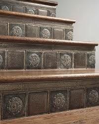 I like the vintage tin tiles better. Cool idea.
