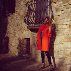 Lady in red. Perfect red coat for summer!