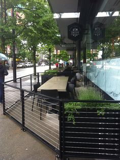 ABODE Restaurant 1223 Robson St - cable railings and concrete tabletops #hoteldesign