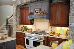 While non-organic colors like blue aren't common in Craftsman kitchens, if they are used, they should be dusky and faded, like the vent hood in the kitchen below. This Craftsman kitchen leans more towards rustic, substituting a lot of wood for natural stone brick.