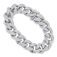 This eye-catching 14K Gold Miami Cuban Link Chain Diamond Bracelet for Men weights approximately 73 grams and showcases 11.05 carats of sparkling round cut white diamonds masterfully pave set into cuban links. Featuring a unique design this amazing mens diamond bracelet is available in 14K yellow, white and rose gold.