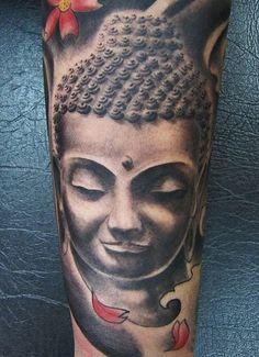 Black and white Buddha tattoo