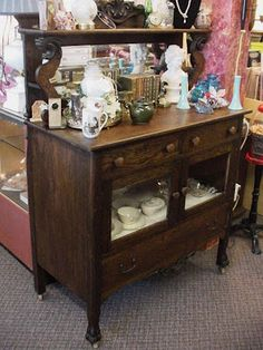 Antique sideboard buffet...details include claw and ball foot and lion head shelf support...awesome!