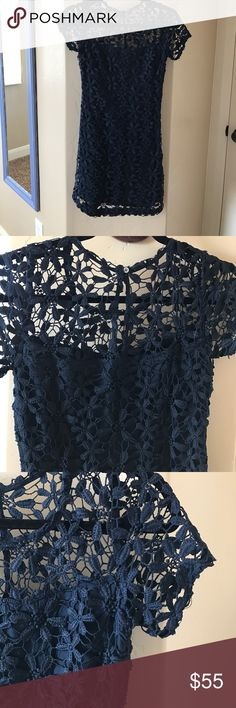 Cute navy blue flower lace over lay dress I love this dress! Last picture is of me in the dress. Sits right above my knee, only worn once (pictured) size extra small, true to size. Sheer lace top, short-sleeved. Love this style, very comfortable. Hollister Dresses Mini