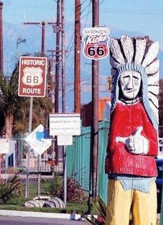 This is in front of the Wigwam Motel, looking east. A traditional Route 66 sign is at left; the new Kicks on 66 sign is at right.