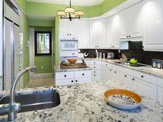 Pretty green condo kitchen - transitional.  Mansion la Palma at Bay Colony | Naples, Florida