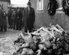 Kentucky Senator Alben W. Barkley witnesses firsthand the evils of Nazism via Weimar, Germany's Buchenwald concentration camp.