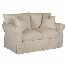 """Offer guests a seat at your next soiree or indulge in your latest read with this timeless upholstered loveseat, featuring classic rolled arms and a tailored skirt. Product: LoveseatConstruction Material: Wood, tempered steel, foam and polyesterColor: Creamy whiteFeatures:  Down blend cushions Two pillows included    Dimensions: 31""""  H x 65""""  W x 40""""  D"""