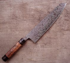 damascus steel I love how the Damascus steel matches the burl-wood handle.
