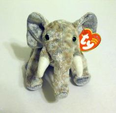 """TY BEANIE BABY """"POUNDS"""" THE ELEPHANT    DATE OF BIRTH: 30th March 2002  6"""" Pounds the elephant  RETIRED  Marching across the dusty ground You'll hear me from miles around My trunk is swinging to and fro Listen to my trumpet blow!  THIS BEANIE IS IN..."""