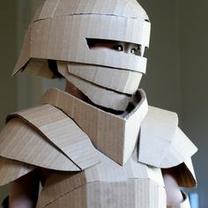 Warren King created a fantastical knight's armor completely out of cardboard. How did he make this cardboard costume DIY? Cardboard Costume, Cardboard Mask, Cardboard Sculpture, Cardboard Paper, Cardboard Crafts, Diy Knight Costume, Knight Costume For Kids, Kids Costumes Boys, Boy Costumes
