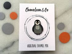 This listing is for a baby penguin enamel pin. Our cute penguin pin makes a gorgeous addition to a pin collection. It would make a great Christmas gift or stocking filler. The pin features our original penguin artwork. Size: 3cm Pin type: hard enamel pin with black nickel backing