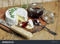 Delicious camembert cheese with cranberry on wooden background  appetizer , board , breakfast , brie , camembert , cheese , cranberry , cream , creamy , cuisine , cut , dairy , delicious , diet , dinner , dish , food , french , fresh , gourmet , green , healthy , herb , ingredient , italian , knife , leaves , meal , milk , organic , photography , piece , product , rosemary , round , rustic , slice , snack , soft , spoon , sweet , tasty , top , traditional , vegetarian , white , wood , wooden…