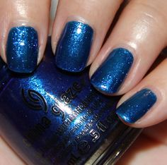 Blue Year's Eve is a super shimmery glass flecked blue. It's deep yet bright at the same time. No issues with the formula except should use three coats instead of two because the base is a bit sheer. //China Glaze Blue Year's Eve.jpg