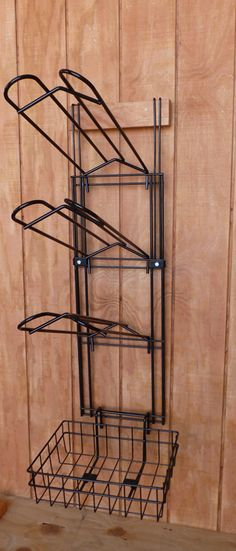 """Wall mount saddle rack with basket organizer. Comes with 3 saddle racks, one large basket for stuff. Wall mounts or hangs over a 2"""" wall."""