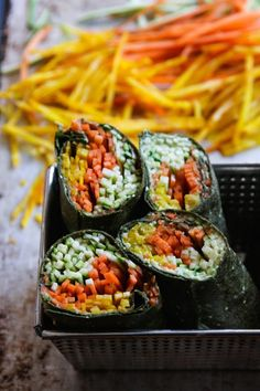 This Rawsome Vegan Life: RAWSOME WRAPS: spinach tortillas filled with mashed avocado and shredded veggies