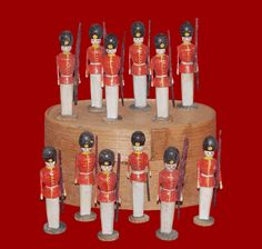 Twelve wooden soldiers, circa 1900