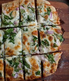 Spinach Ranch Pizza. Homemade ranch dressing, and spinach, red onions, and lots of mozz cheese on top. Pour the wine:)