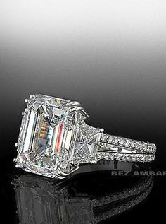 Emerald cut center stone trio with split shank mounting by Bez Ambar.