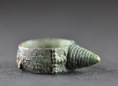 Amlash Luristan bronze funnel ring 13, 1st millenium B.C. Amlash bronze funnel ring, 1.8 cm diameter ring size, 7.3 gr weight. Private collection For more Amlash bronze funnel rings please visit https://it.pinterest.com/andreacanecane/amlash-bronze-funnel-rings/?etslf=4134&eq=funnel%20ring