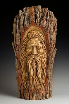 Wood Spirit in a block of wood.. I want to make some of these at camp and put them in random places near camp...