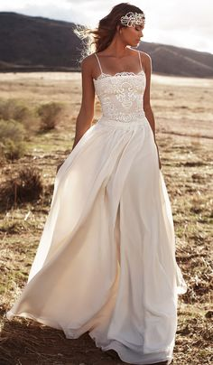 Inspired by designer Lurelly. The Mari gown is a gorgeous, bohemian style beach gown that embodies the free-spirited woman! A simple lace over lay, spaghetti-strap top meets a natural waistline that f