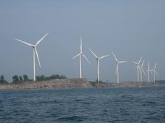 Wind turbines on the shore of Lake Erie, Buffalo, NY could lull me into a mid summer's nap on the beach