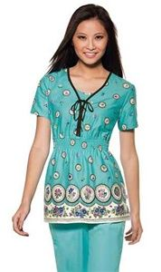 """Skechers Women's Empire Waist Scrub Top in """"Vintage Splendor"""" 25733C-VINS A fashion forward top features a border print and lace-up front detail. Also featured is a dickie inset, contrast neck binding and tie, all around elasticized smocked empire waistband, two side angled pockets, and side vents. Center back length: 26 1/2"""" $25.50 #scrubs #scrubcouture #nurses #doctors"""