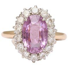 Pink Sapphire  Diamond Ring Tiffany & Co. oval Pink Sapphire approximate weight 3.50 carats 14 round diamonds 1.20 carats. Circa 1920