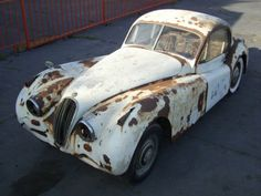 Learn more about 1954 Jaguar FHC on Bring a Trailer, the home of the best vintage and classic cars online. Classic Cars British, British Sports Cars, Old Classic Cars, Classic Cars Online, Abandoned Cars, Abandoned Vehicles, Abandoned Places, Jaguar Xk120, Train Truck