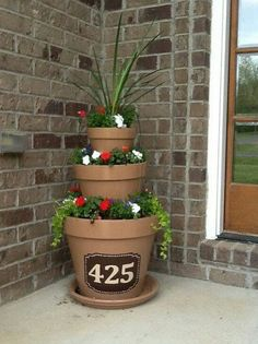Address painted on painted terra cotta pot sculpture