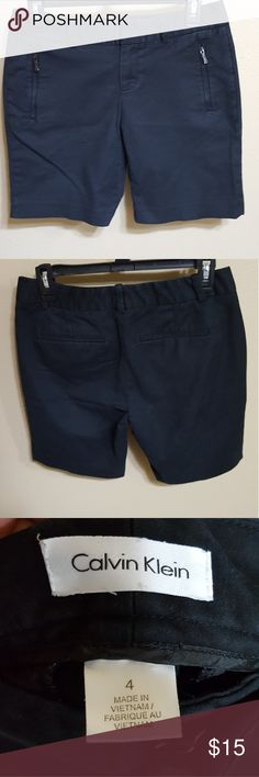 Calvin Klein Shorts Size 4  Good condition  Let me know if you would like measurements!  Has cute pocket detail Washout, but not very bad. Calvin Klein Shorts